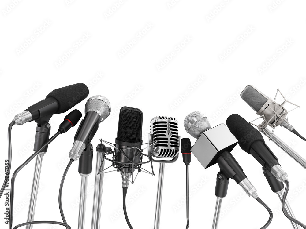 Fototapeta Various microphones aligned at press conference isolated over a