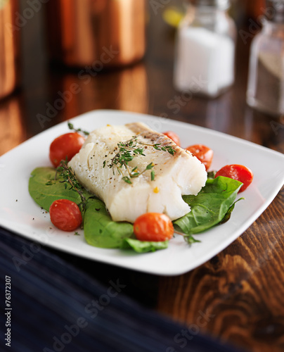 halibut with spinach, cherry tomatoes and thyme Fototapeta