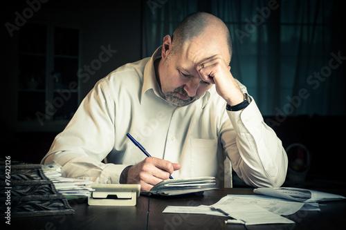 Fotografie, Obraz Man working on household finances