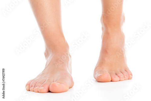 Fotografie, Obraz  Woman legs isolated foot stepping