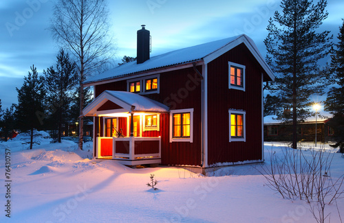 wooden house in Sweden during winter Canvas-taulu