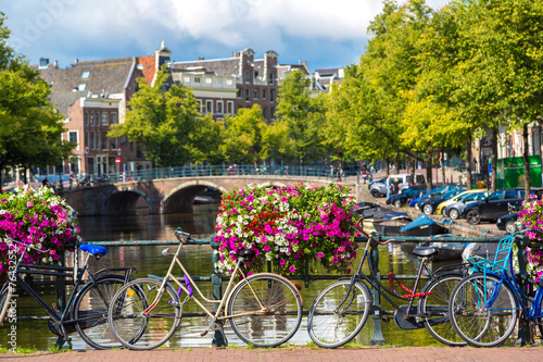 Ingelijste posters Amsterdam Bicycles on a bridge over the canals of Amsterdam