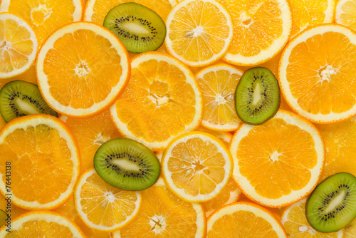 Vászonkép Sliced healthy fruits background