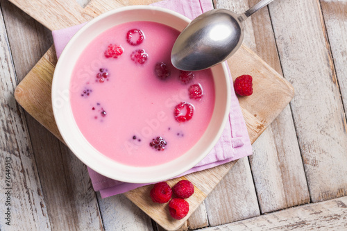 Fresh fruit soup with raspberries and blackberries