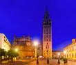 Giralda tower - bell tower of the Seville Cathedral in evening