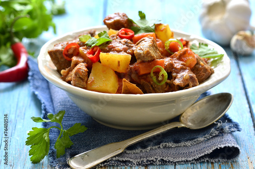Fotografie, Obraz  Meat stewed with vegetable in spicy tomato sauce.