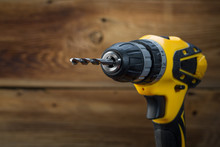 Electric Drill On A Wooden Bac...