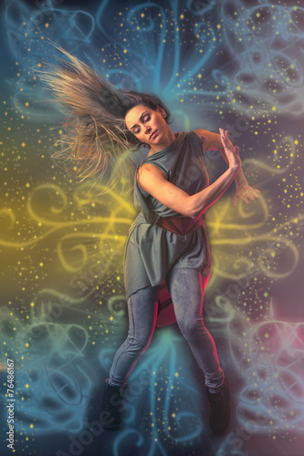 Foto op Plexiglas Zeemeermin Beautiful woman dancer dancing over dark background with light r