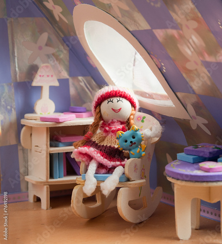 Photo  doll in a chair