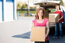 Storage: Couple Putting Boxes Into Storage