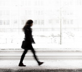 Young woman walking in winter - 76523738
