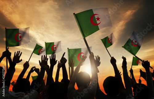 Photo Silhouettes People Holding Flag Algeria Concept