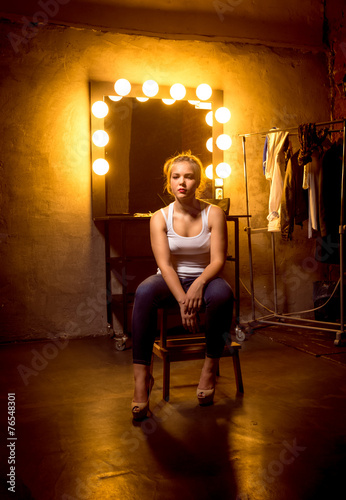 Fotografie, Obraz  blonde woman posing on chair at dressing room in theater