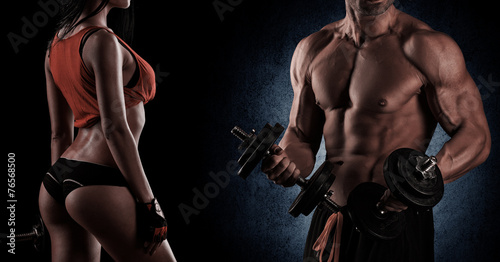 Fotografie, Obraz Bodybuilding. Strong man and a woman posing on a black backgroun
