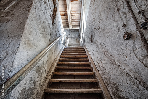 Wooden stairs in an abandoned house