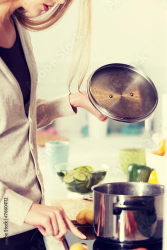 Deurstickers Ontspanning Beautiful caucasian woman is cooking.