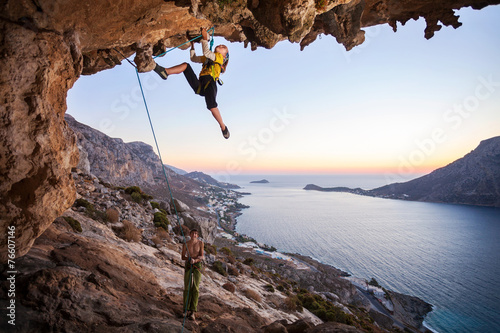 Fototapeta Seven-year old girl climbing a challenging route obraz