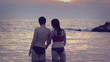 Lovers kissing in the sea at sunset - love - man and woman kiss - Lovers kissing