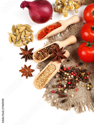 Tuinposter Kruiden 2 Different spices and herbs in wooden spoons isolated on white