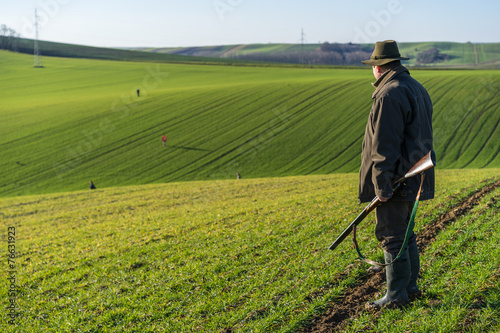 Fotografie, Obraz  Gamekeeper walks over field.