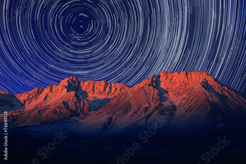 Fototapeta Night Exposure Star Trails of the Sky in Bishop California