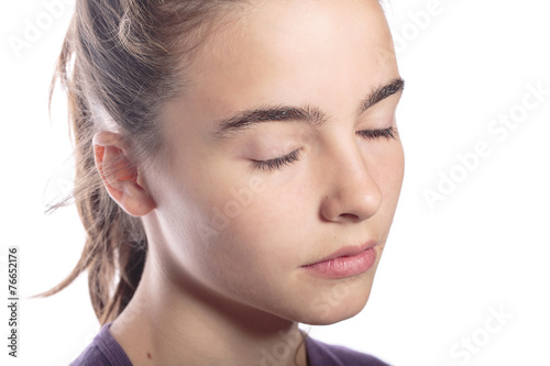 Photo  portrait of a teenage girl with closed eyes, isolated on white