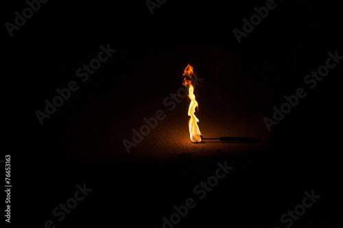 Fotografía Burning Torch in the Night at black background