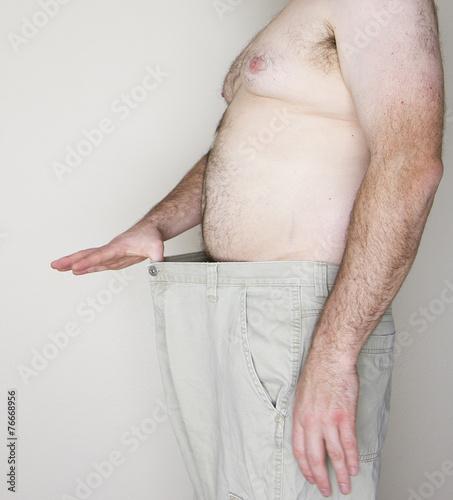 Photo  Heavy set man losing weight