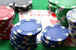 Red, blue, green, white and black poker chips and royal flush