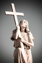 Statue Of Woman With Cross