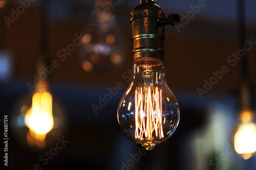 Photo  glowing vintage tungsten lamps