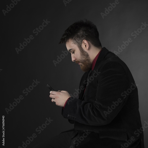 Fotografia, Obraz  Man in Formal Attire with Phone in Side View