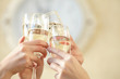 canvas print picture - Glasses of champagne in female hands on a party