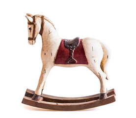Fototapetavintage rocking horse isolated on white