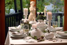 White Table Decoration With Pumpkins And Candles