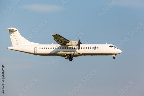 Fotografia, Obraz  white passenger turboprop aircraft