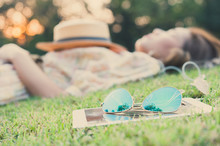Fasion Sun Glasses With Young Woman Sleeping In Background, Vint