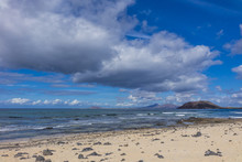 View Of Lobos From Corralejo Beach With Dramatic Cloads