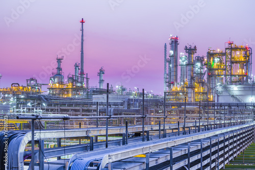 Foto op Canvas Planten Twilight of industrial petroleum plant