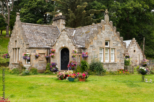 Photo  English cottage in greenery