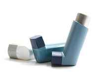 Asthma Inhaler Isolated On Whi...