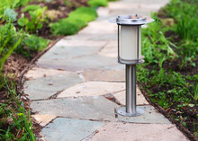 Solar-powered Lamp On Garden Path.