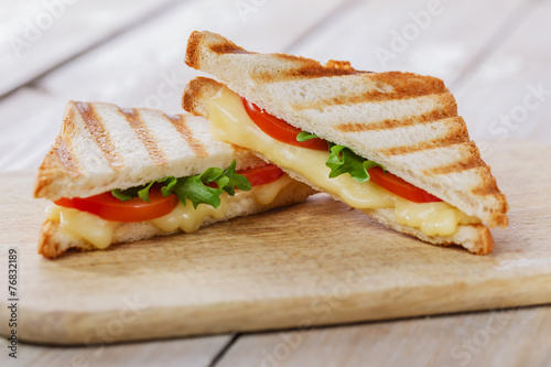 Spoed Foto op Canvas Snack grilled sandwich toast with tomato and cheese