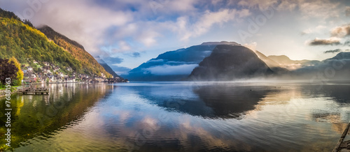 Big panorama of misty lake at dawn in Hallstatt, Austria