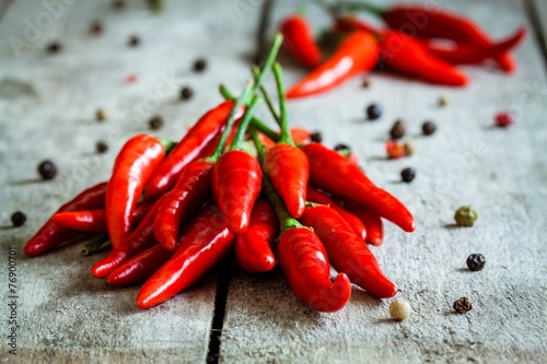 Deurstickers Hot chili peppers red hot chili peppers on a wooden background