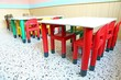 red chairs and small tables in the nursery class