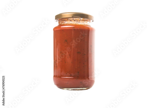 Spaghetti sauce in a jar over white background