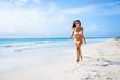 Woman on tropical caribbean vacation having fun