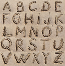 Alphabet (ABC) Written On Sand.