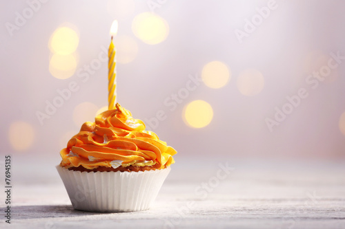 Delicious birthday cupcakes on table on light background Canvas Print